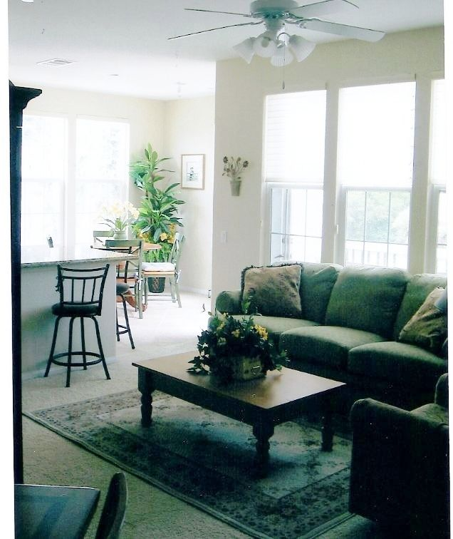 Spotless Chic Ventura Condo living room looking into dining area