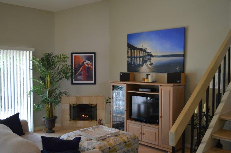 Living room with fireplace in Harbor Lights Home