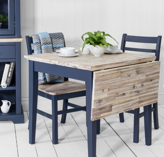 Blue drop-leaf table with natural wood top