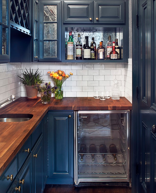 Blue cabinets in a white kitchen