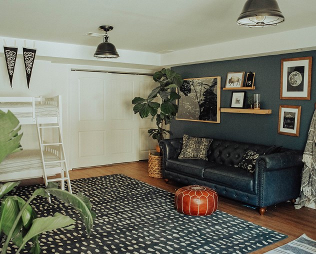 Dark blue accent wall in living space