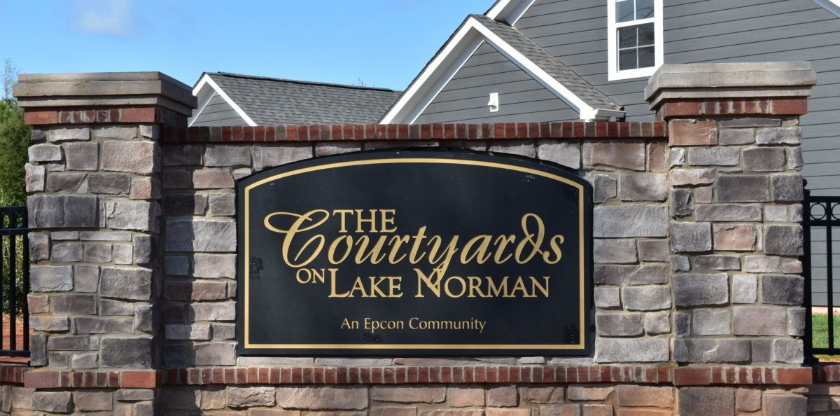 The entrance sign at The Courtyards On Lake Norman