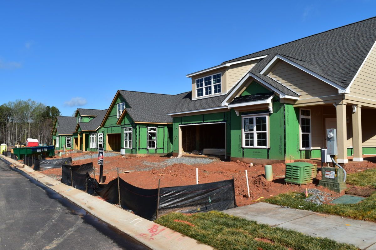 View from the street of homes under construction in The Courtyards On Lake Norman