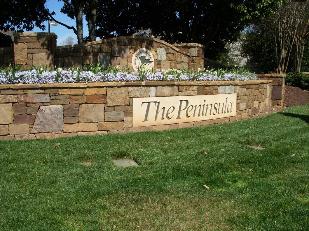 The Peninsula Club Entrance Sign