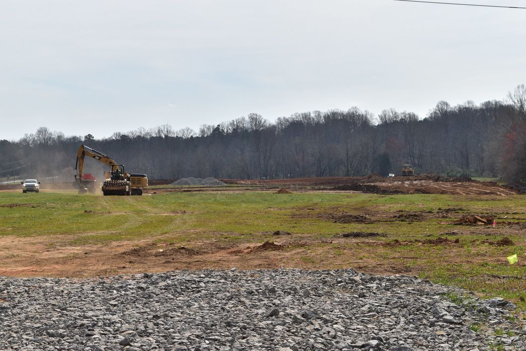 Earthmoving equipment breaking ground at WestBranch in Davidson