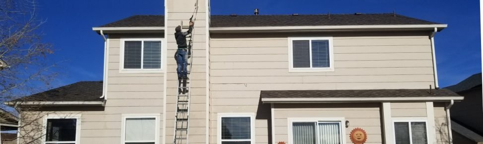Person applying exterior paint