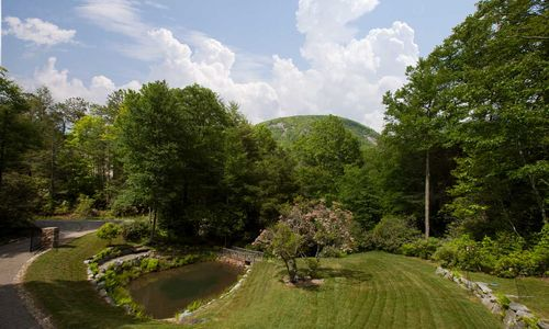https://crop-v3.agentfirecdn.com/meadowsmountainrealty.com/wp-content/uploads/sites/415/2017/07/Exterior-view-from-Living-front-porch-dining-guest-rooms.jpg