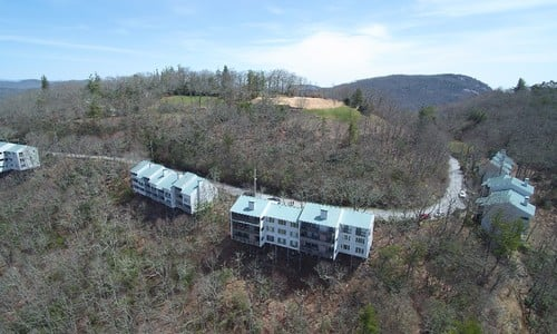 https://crop-v3.agentfirecdn.com/meadowsmountainrealty.com/wp-content/uploads/sites/415/2018/04/602-VZTop-Highlands-NC-Drone-01.jpg