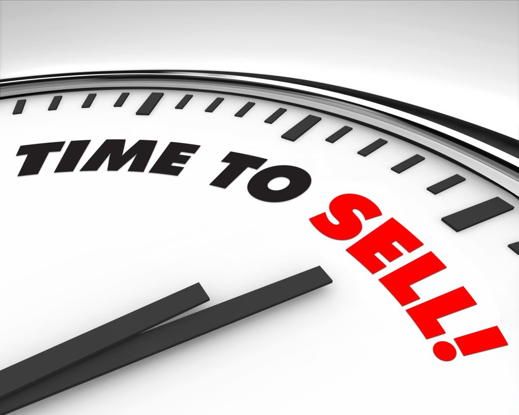 white clock with words time to sell on its face five star realty group