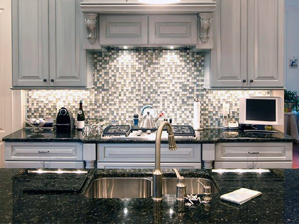 McGranite Countertops - Dark Kitchen Granite Countertop and Patterned Backsplash