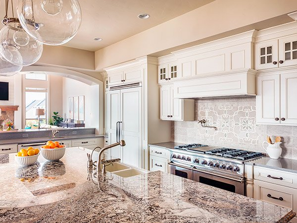 McGranite Countertops - Warmer Kitchen Granite Countertop and Patterned Backsplash