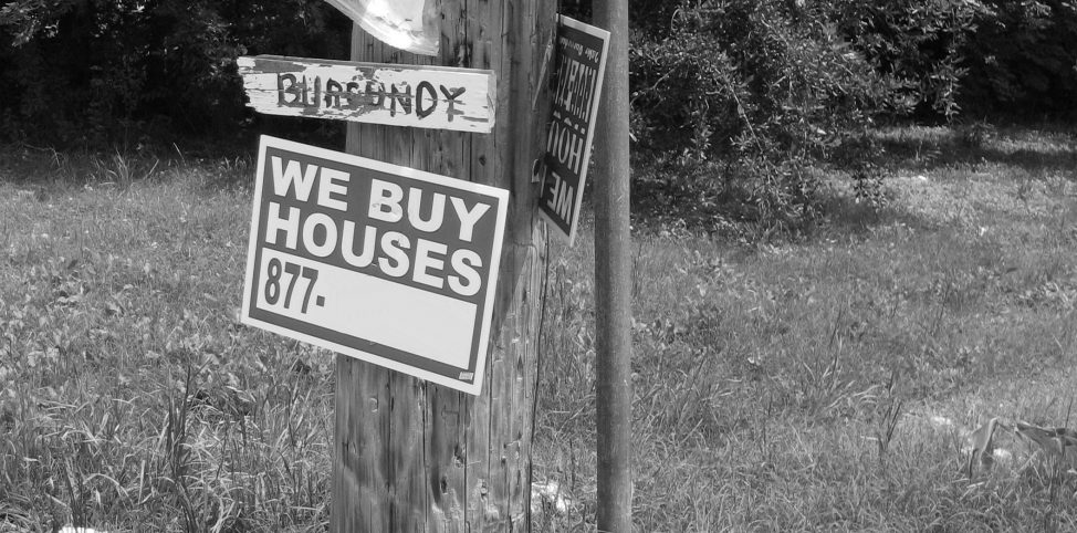 We Buy Houses Sign - Wikimedia - Photo by Infrogmation - June 2007