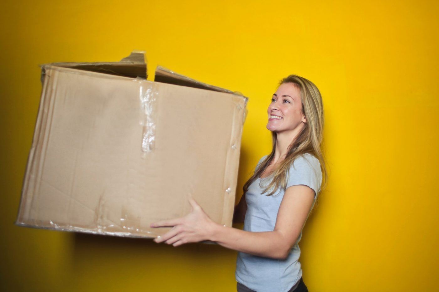 Woman Holding Moving Box