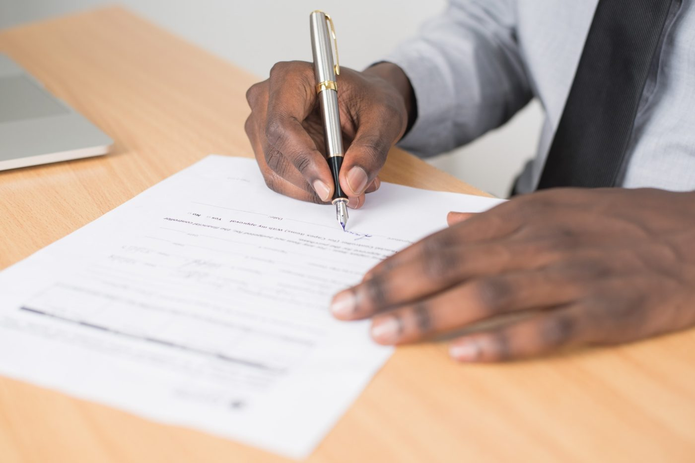 Person Signing Paperwork by Cytonn Photography via Pexels