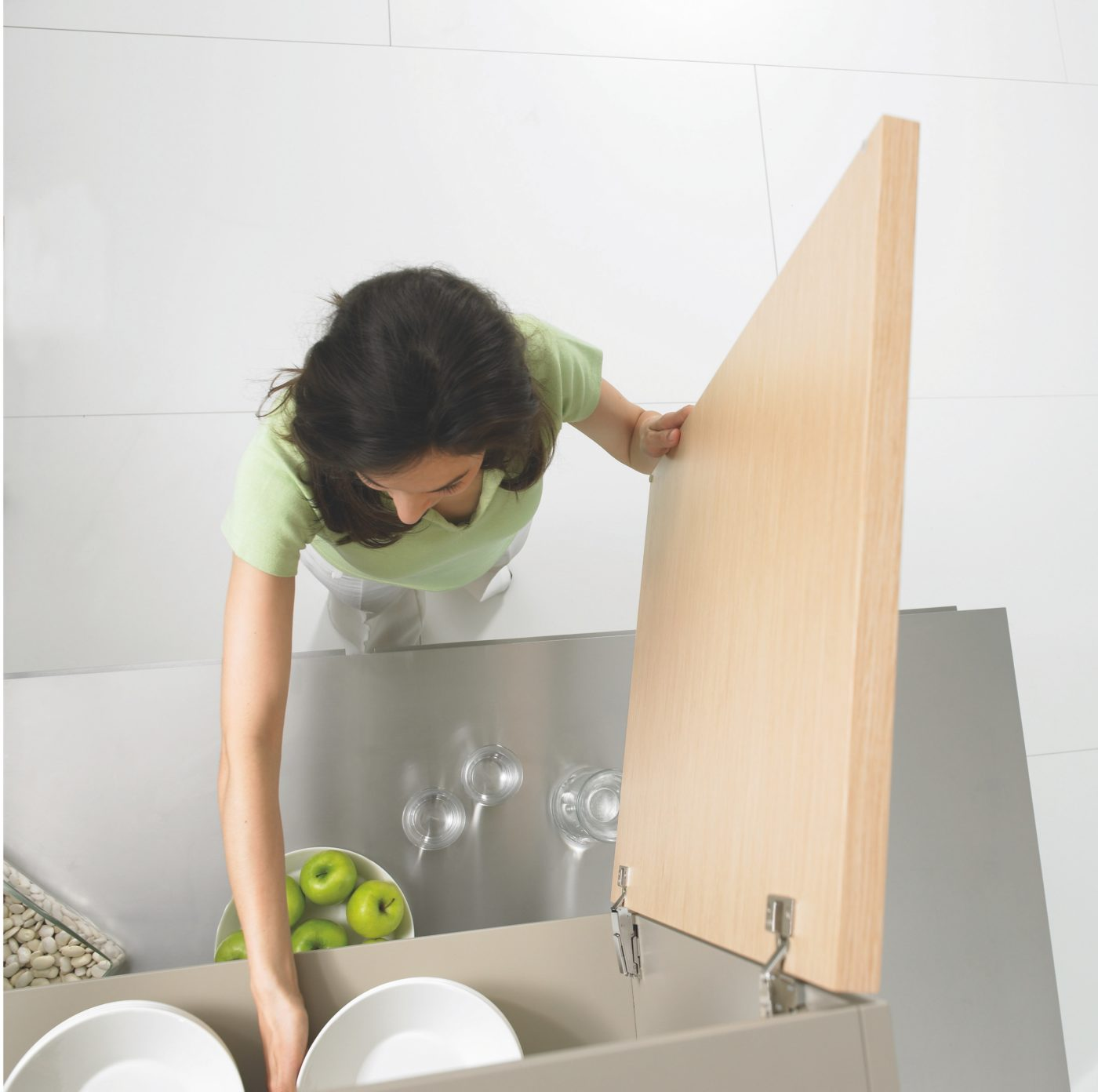 Woman Tidying Up Kitchen