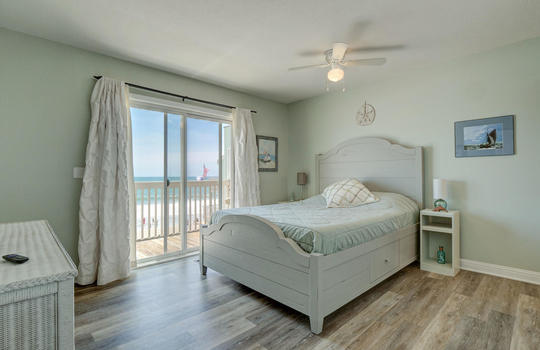 1100 Fort Fisher Blvd N 1403-large-015-009-Master Bedroom-1497×1000-72dpi