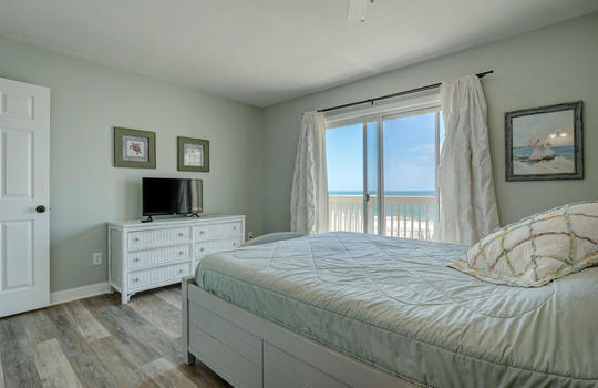 1100 Fort Fisher Blvd N 1403-large-017-013-Master Bedroom-1497×1000-72dpi