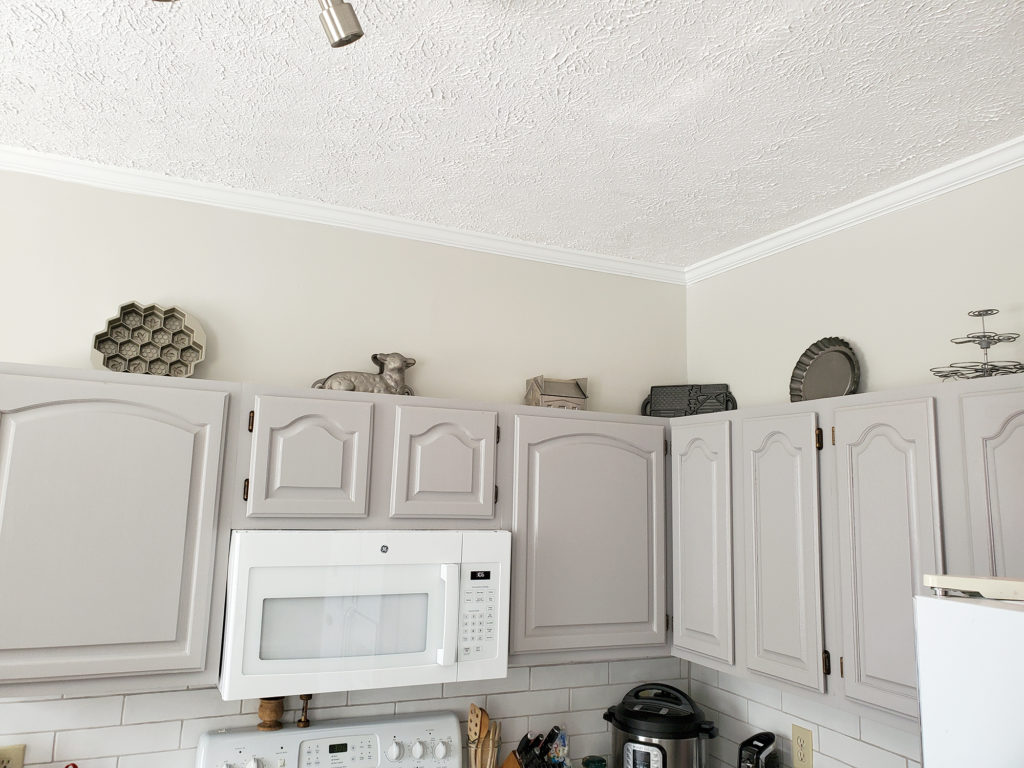Baking Molds On Top of Kitchen Cabinets - The Cameron Team