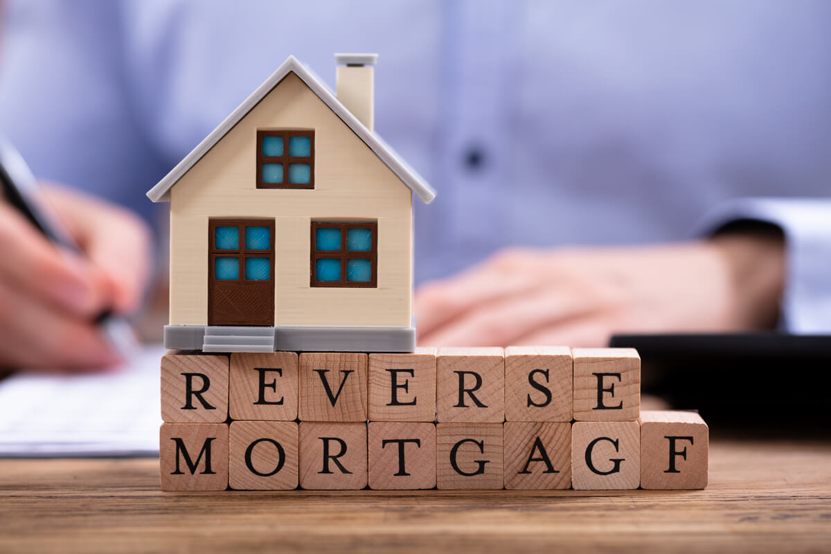"""Home on top of blocks that say """"reverse mortgage"""""""