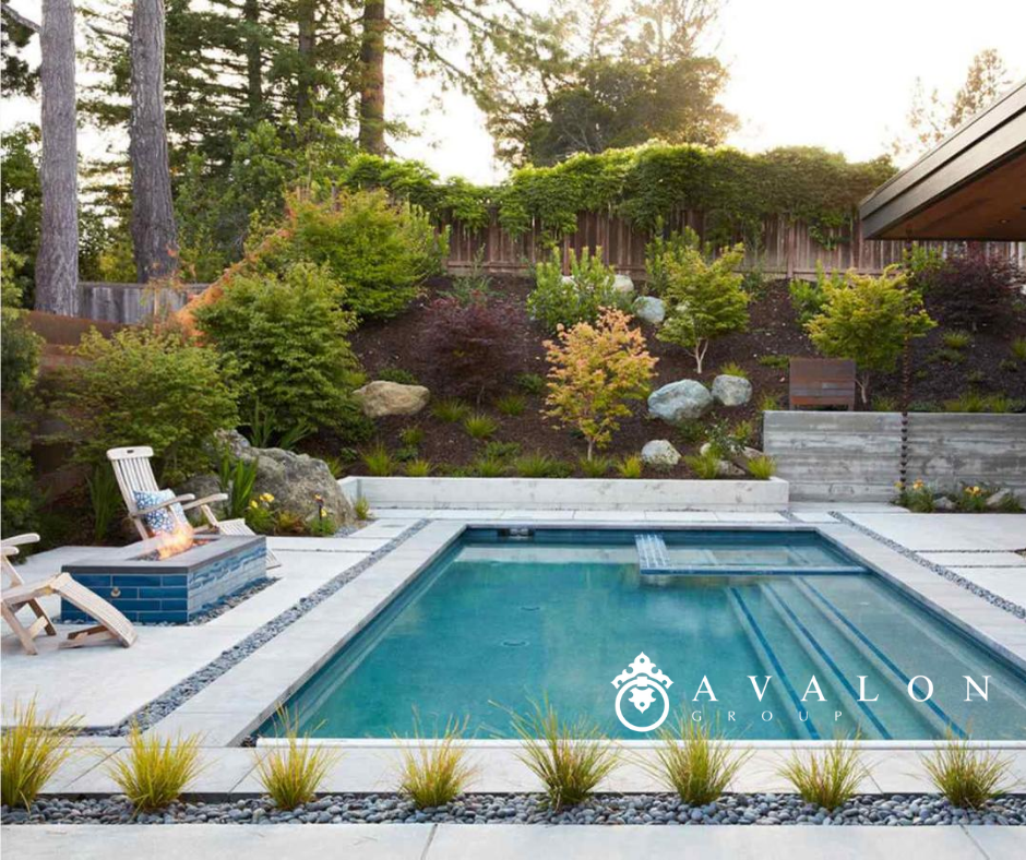 Additionally, the aqua colored pool is clear with many steps. Also the landscaping surrounds the pool cement deck..
