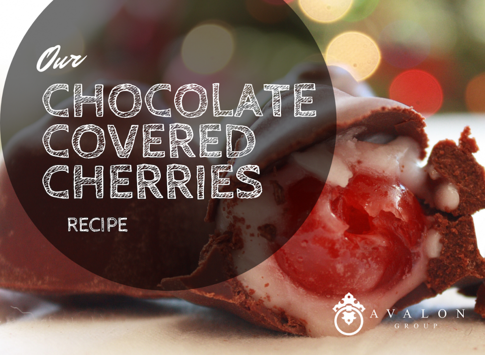 "Cover photo that says ""Our chocolate covered cherries recipe"" There is a chocolate covered cherry sliced open with christmas lights in the background."