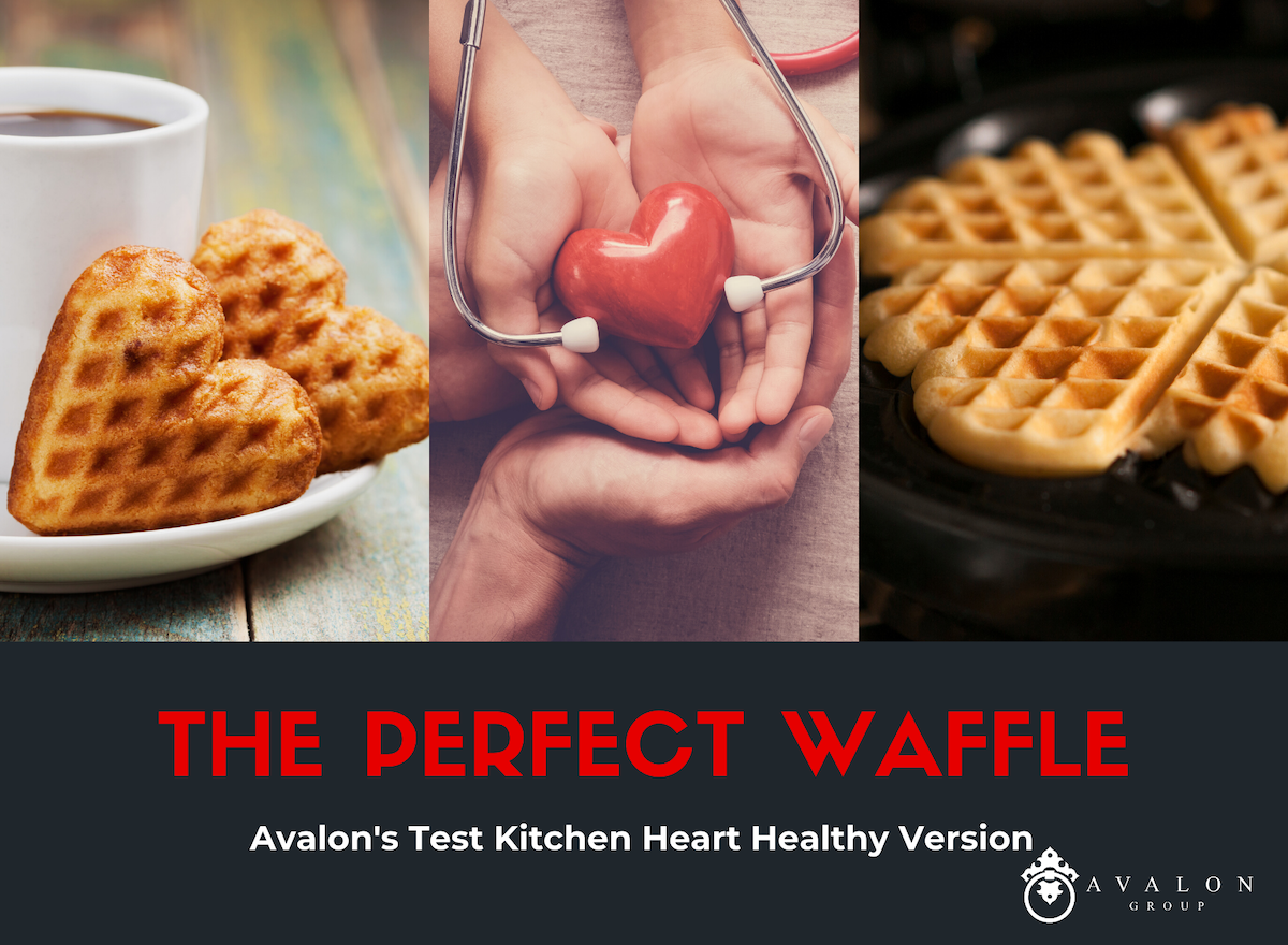 "Text at bottom of picture states ""The Perfect Waffle Avalon's Test Kitchen Heart Healthy Version. Picture includes two heart shaped waffles on the edge of a coffee cup saucer, a group of hands holding a heart with a stethescope surrounding the heart, and finally a heart shaped waffle iron on the right."