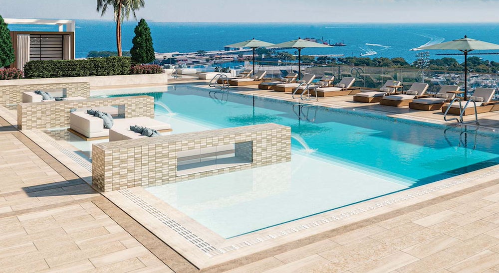 In the same luxury style, the pool in the picture incorporated walls with fountains on the end. Saltaire St Petersburg Luxury Condos pool area also features kingsize beds on islands near the edge.
