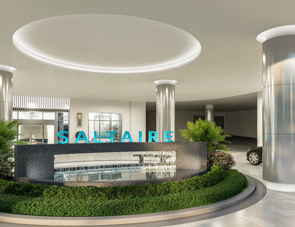 Entrance for valet and drop off at Saltaire Luxury Condos. The Saltaire sign is teal blue letters with a circle indention in the ceiling above.