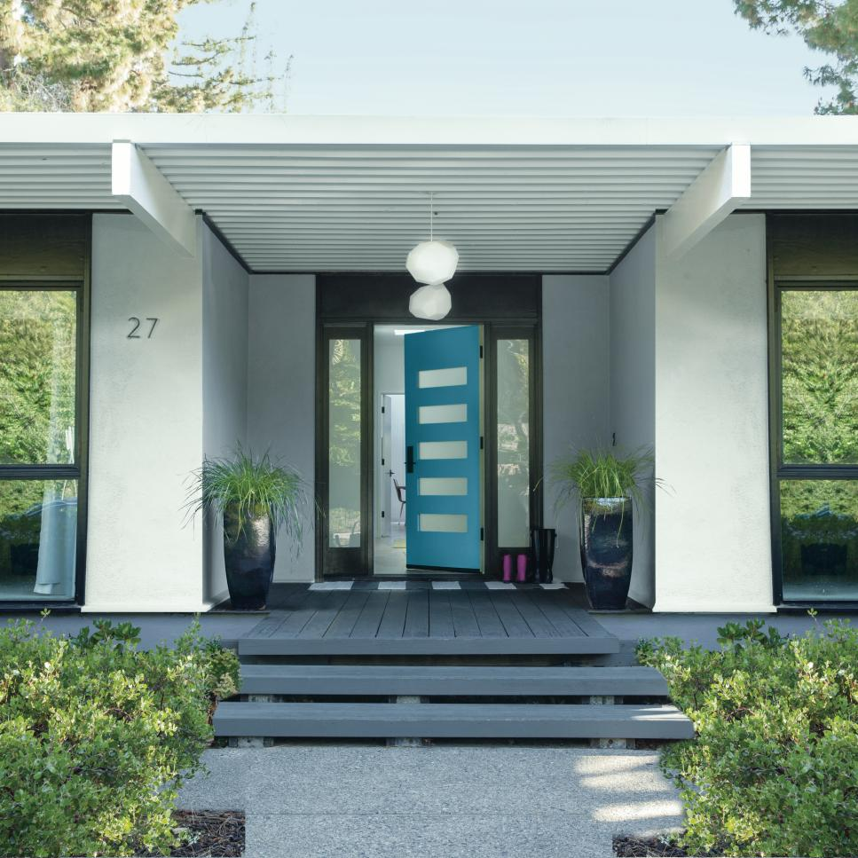 Also our #10 Fairy Tale Blue Benjamin Moore 2055-50 will enhance the summer skies of Florida. Additionally the door is surrounded by gray trim and white stucco.