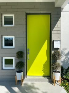 Again, the new chartreuse color is supper happy. It is surrounded by a brick wall painted gray brown.
