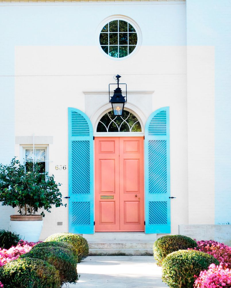 Furthermore there is a door painted#4 Salmon Soufflé 5-11, Pratt & Lambert Paints. The house is Georgian Colonial painted white. Also there are baby blue shutters on each side.