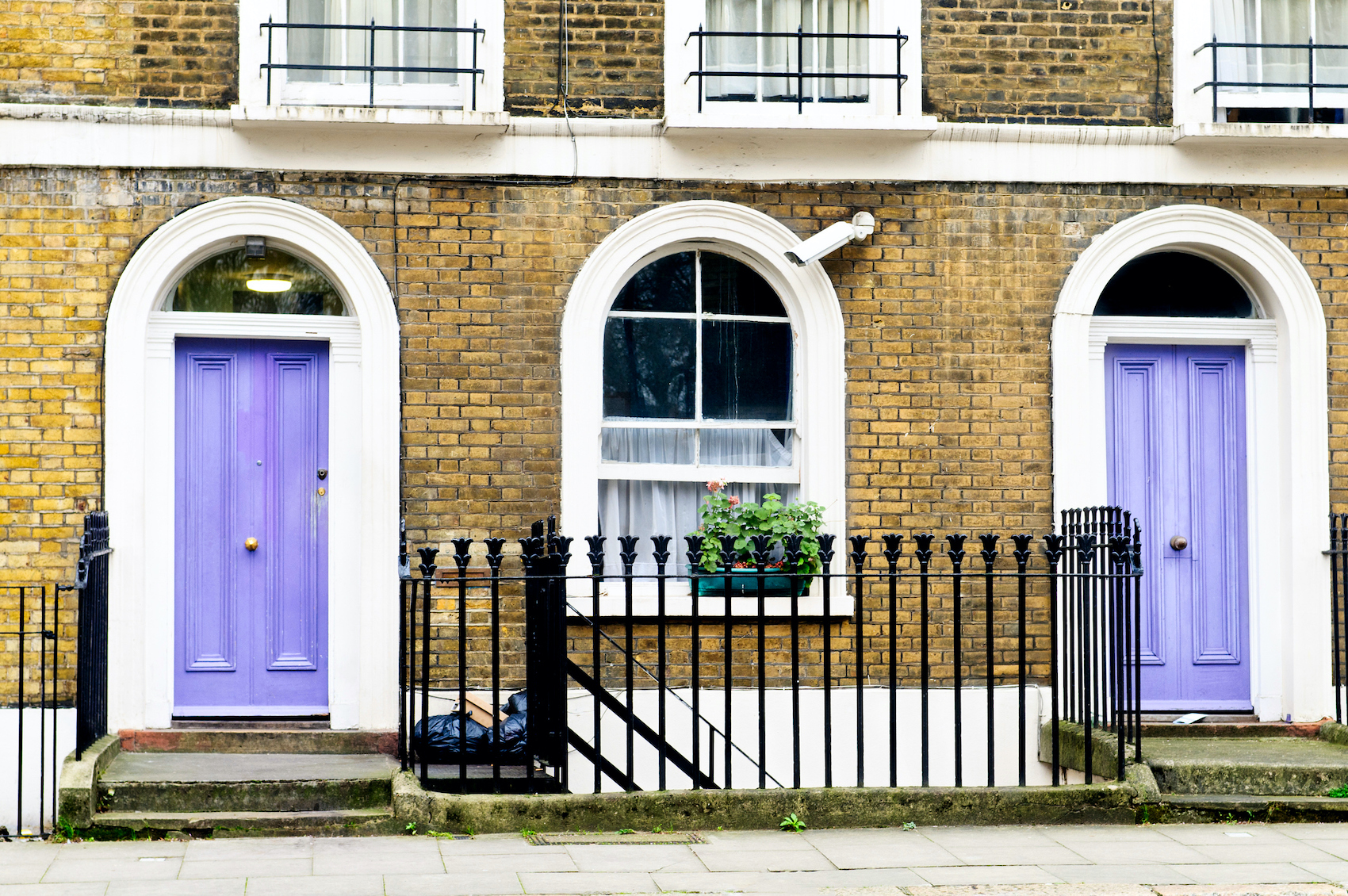 Ninth is #9 California Lilac 2068-40 Benjamin Moore. In the picture the door is surrounded by white trim and brick walls. Moreover the purple color is light purple with a touch of pink.