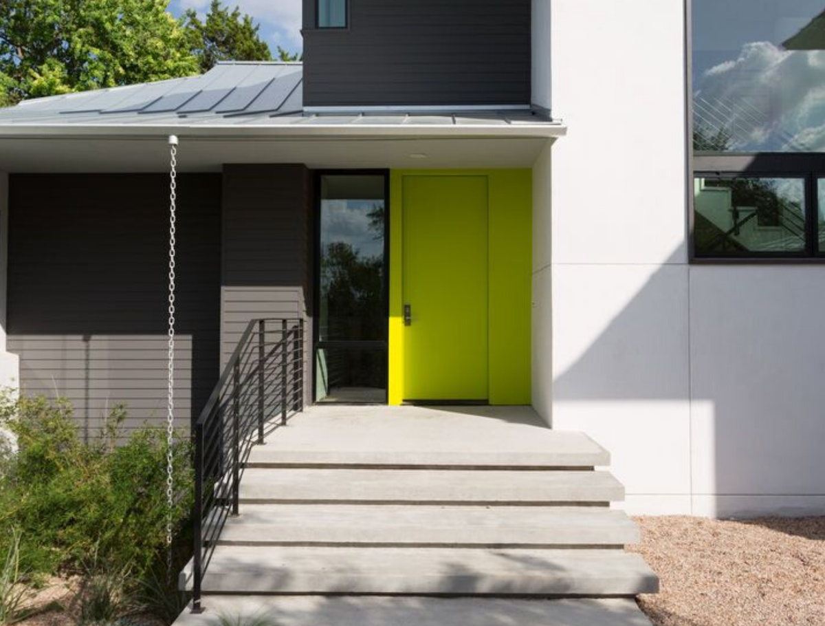 A picture of our #3 Benjamin Moore Yew Green 2025-20 Florida Happy Front Door Color. Also, the chartreuse door is boosted by a white house color.