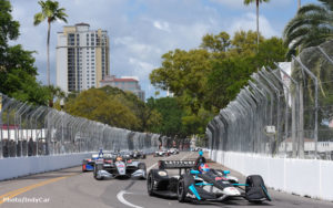 Therefore, the race cars can be seen in this pic next to high rise condo buildings.  The streets are lined with oak trees and palm trees.