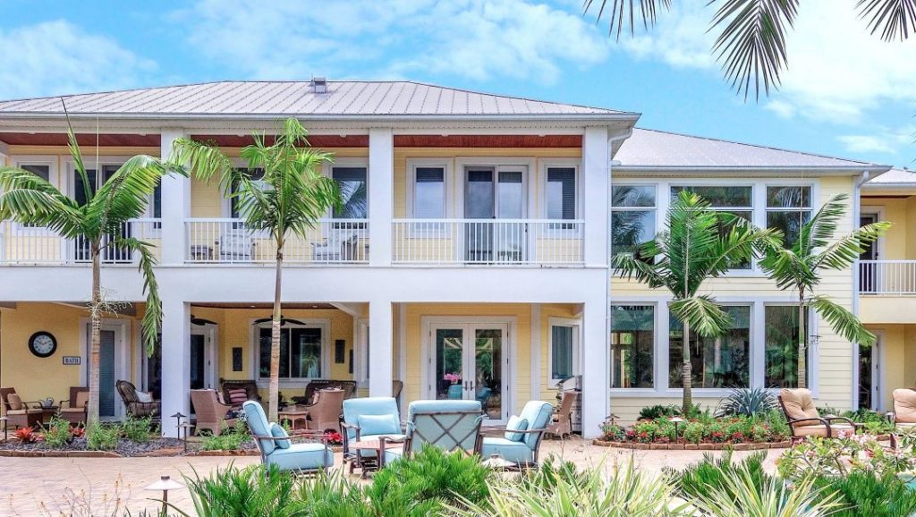 "Use Montgomery Palms to bring a Fiji feel to your ""Paradise"". Furthermore, the house in the picture is a peach color."