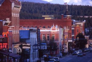 View of Leadville's historic main street buildings with forest and mountains in the background