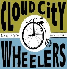 Cloud City Wheelers logo - pea green on top, baby blue on bottom, with penny-farthing bicycle in the center