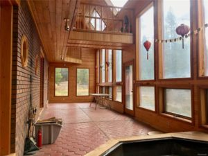 Open room with terracotta tile and 2-story windows