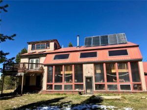 Exterior of home showing sunroom, solar panels