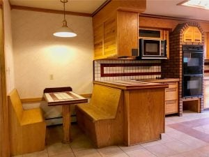 Breakfast nook with bench seats and tile counters