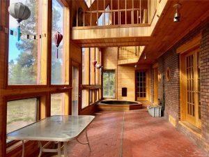 Terracotta tiling, huge windows, upper level wooden walkway