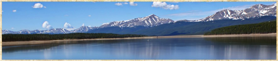 Panoramic shot of a lake with mountains in the background